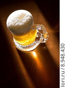 Купить «Mug of beer on wooden table », фото № 8948430, снято 27 мая 2020 г. (c) PantherMedia / Фотобанк Лори