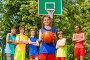 Девочка с мячом и её баскетбольная команда на площадке, фото № 9104146, снято 3 июня 2015 г. (c) Сергей Новиков / Фотобанк Лори