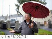 Купить «Mature male with umbrella», фото № 9106742, снято 23 апреля 2019 г. (c) PantherMedia / Фотобанк Лори