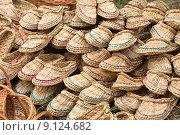 Купить «Тапочки плетёные из аира», фото № 9124682, снято 18 июля 2015 г. (c) Евгений Анкудинов / Фотобанк Лори