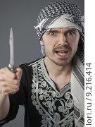 Купить «angry palestinian with knife», фото № 9216414, снято 27 июня 2019 г. (c) PantherMedia / Фотобанк Лори