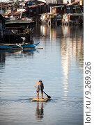 Купить «Man on raft - squatter shanty area», фото № 9269926, снято 27 июня 2019 г. (c) PantherMedia / Фотобанк Лори