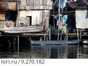 Купить «shanty squatter homes along Philippine river», фото № 9270182, снято 19 марта 2019 г. (c) PantherMedia / Фотобанк Лори