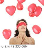 Купить «Young charming sensual woman blindfold with falling heart shaped baloons, over white», фото № 9333066, снято 20 января 2019 г. (c) PantherMedia / Фотобанк Лори