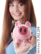 Купить «Young woman with her piggy bank, isolated on white background », фото № 9362294, снято 24 апреля 2019 г. (c) PantherMedia / Фотобанк Лори