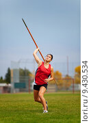 Купить «A young, female athlete throwing a javelin in a track and field event.», фото № 9430534, снято 14 декабря 2017 г. (c) PantherMedia / Фотобанк Лори