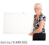 Купить «Senior Businesswoman Holding a Blank Sign», фото № 9449502, снято 14 декабря 2018 г. (c) PantherMedia / Фотобанк Лори