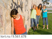 Купить «school bully or bullies bullying sad lonely child», фото № 9561678, снято 16 сентября 2018 г. (c) PantherMedia / Фотобанк Лори