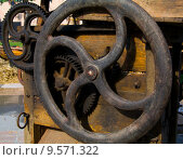 Купить «A number of cogwheels on a old agricultural machine», фото № 9571322, снято 15 августа 2018 г. (c) PantherMedia / Фотобанк Лори
