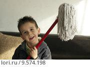 Купить «Children who clean the floor», фото № 9574198, снято 29 января 2020 г. (c) PantherMedia / Фотобанк Лори