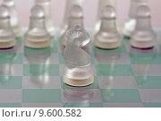 Купить «Close up of horse of chess over glass chessboard», фото № 9600582, снято 21 сентября 2019 г. (c) PantherMedia / Фотобанк Лори