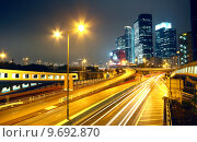 Купить «urban landscape at night and through the city traffic », фото № 9692870, снято 19 сентября 2019 г. (c) PantherMedia / Фотобанк Лори