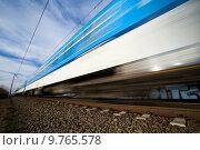 Купить «Fast train passing through countryside», фото № 9765578, снято 18 июня 2019 г. (c) PantherMedia / Фотобанк Лори
