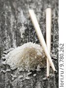 Купить «raw white rice with chopsticks close up», фото № 9780262, снято 23 июля 2019 г. (c) PantherMedia / Фотобанк Лори
