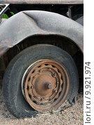 Купить «Flat tyre», фото № 9921974, снято 27 июня 2019 г. (c) PantherMedia / Фотобанк Лори