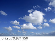 Купить «Blue beautiful sky with white clouds  in sunny day», фото № 9974950, снято 15 сентября 2019 г. (c) PantherMedia / Фотобанк Лори