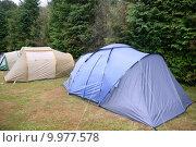 Купить «Camping tent field over green grass», фото № 9977578, снято 25 апреля 2019 г. (c) PantherMedia / Фотобанк Лори