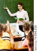 Купить «Explanation of teacher», фото № 9994930, снято 21 июля 2019 г. (c) PantherMedia / Фотобанк Лори