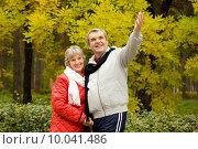 Купить «Photo of senior man showing something to his wife during walk in autumn forest», фото № 10041486, снято 21 января 2018 г. (c) PantherMedia / Фотобанк Лори