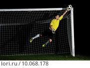 Купить «goalkeeper  soccer player people  on football stadium grass field», фото № 10068178, снято 25 апреля 2019 г. (c) PantherMedia / Фотобанк Лори