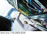 Купить «it engineers in network server room», фото № 10069654, снято 22 апреля 2019 г. (c) PantherMedia / Фотобанк Лори