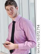 Купить «young business man talk by cellphone», фото № 10072714, снято 18 февраля 2020 г. (c) PantherMedia / Фотобанк Лори