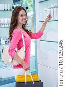 Купить «Pretty woman shopping for cosmetics», фото № 10129246, снято 25 февраля 2015 г. (c) Wavebreak Media / Фотобанк Лори