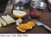 Купить «Orange, melon and mango preparation for fruit salad», фото № 10180754, снято 21 мая 2019 г. (c) PantherMedia / Фотобанк Лори