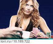 Купить «Woman doubt in a card gambling match», фото № 10189722, снято 17 июня 2019 г. (c) PantherMedia / Фотобанк Лори