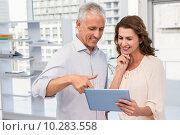 Купить «Casual business colleagues working with tablet», фото № 10283558, снято 5 мая 2015 г. (c) Wavebreak Media / Фотобанк Лори