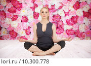 Купить «happy young woman meditating in yoga lotus pose», фото № 10300778, снято 24 марта 2011 г. (c) Syda Productions / Фотобанк Лори
