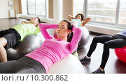 Купить «happy people flexing abdominal muscles on fitball», фото № 10300862, снято 5 апреля 2015 г. (c) Syda Productions / Фотобанк Лори