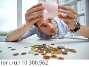 Купить «businessman with piggy bank and coins at office», фото № 10300962, снято 18 июня 2015 г. (c) Syda Productions / Фотобанк Лори