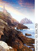 Купить «Ocean rocky coast with lighthouse», фото № 10304750, снято 18 июня 2019 г. (c) Яков Филимонов / Фотобанк Лори