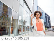 Купить «happy young african american businesswoman in city», фото № 10305258, снято 8 июля 2015 г. (c) Syda Productions / Фотобанк Лори
