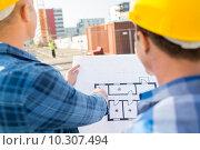 Купить «close up of builders with blueprint at building», фото № 10307494, снято 21 сентября 2014 г. (c) Syda Productions / Фотобанк Лори
