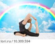 Купить «happy young woman doing yoga exercise», фото № 10309594, снято 24 марта 2011 г. (c) Syda Productions / Фотобанк Лори