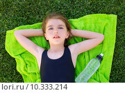 Купить «children girl relaxed lying on towel over green grass», фото № 10333214, снято 19 ноября 2018 г. (c) PantherMedia / Фотобанк Лори