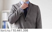 Купить «close up of man in suit adjusting necktie», видеоролик № 10441398, снято 12 апреля 2015 г. (c) Syda Productions / Фотобанк Лори