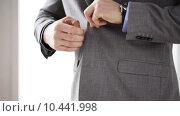 Купить «close up of man in suit fastening button on jacket», видеоролик № 10441998, снято 12 апреля 2015 г. (c) Syda Productions / Фотобанк Лори