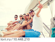 Купить «smiling friends sitting on yacht deck», фото № 10448210, снято 13 июля 2014 г. (c) Syda Productions / Фотобанк Лори