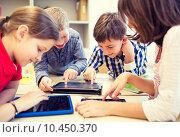 Купить «group of school kids with tablet pc in classroom», фото № 10450370, снято 15 ноября 2014 г. (c) Syda Productions / Фотобанк Лори