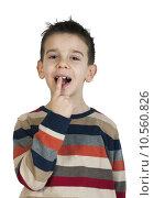 Купить «Child shows his tooth», фото № 10560826, снято 26 февраля 2018 г. (c) PantherMedia / Фотобанк Лори