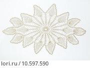 Купить «Crocheted lace on white», фото № 10597590, снято 21 июля 2015 г. (c) Ярочкин Сергей / Фотобанк Лори