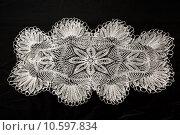 Купить «Crocheted lace napkin», фото № 10597834, снято 22 июля 2015 г. (c) Ярочкин Сергей / Фотобанк Лори