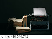 Купить «Old typewriter with books retro colors on the desk», фото № 10740742, снято 15 октября 2019 г. (c) PantherMedia / Фотобанк Лори