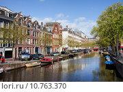 Купить «Boats on Amsterdam Canal», фото № 10763370, снято 27 мая 2019 г. (c) PantherMedia / Фотобанк Лори