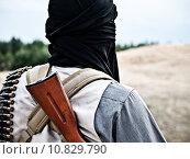 Купить «Muslim rebel with automatic rifle and machine-gun belt», фото № 10829790, снято 24 июня 2019 г. (c) PantherMedia / Фотобанк Лори