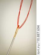 Купить «needle eye with red thread», фото № 10887694, снято 22 февраля 2020 г. (c) PantherMedia / Фотобанк Лори