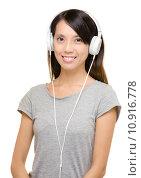 Купить «Asian woman using headphone», фото № 10916778, снято 23 марта 2019 г. (c) PantherMedia / Фотобанк Лори